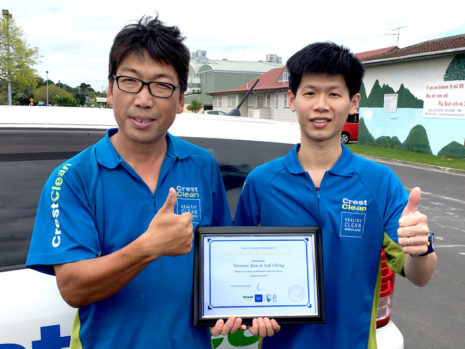 Weimin Yan and Zak Cheng with their award.