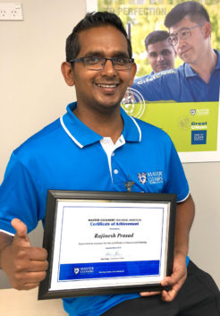Rajinesh Prasad with his Master Cleaners Training Institute Certificate of Achievement.