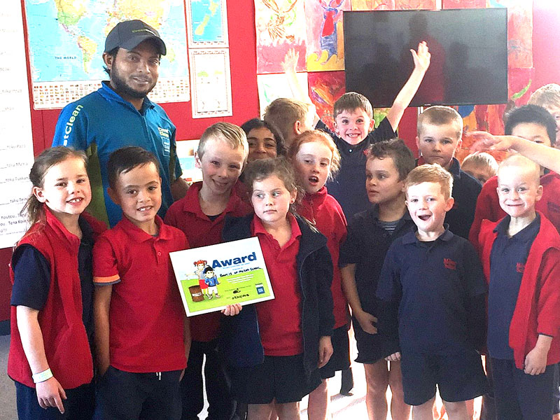 Aznayne Ali hands out the Cleanest Classroom Award at Milson School, Palmerston North.