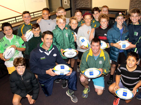 John Leslie (left) and Mike Williams, Mount Sports Junior Rugby chairman, with the under 12s team.