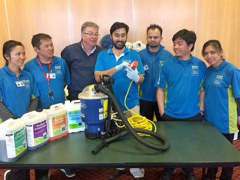 Ashneer Datt shows CrestClean personnel tips on the safe use of a vacuum cleaner. Looking on is Adam Hodge, CEO of the Master Cleaners Training Institute.
