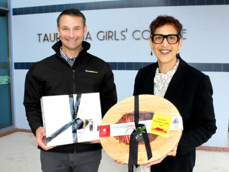 Tauranga Girls' College Principal Tara Kanji receives a gift pack and cutting board from Jan Lichtwark, CrestClean's Tauranga Regional Manager.