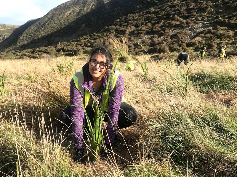 Zainab Ali during the flax planting at Baring Head.