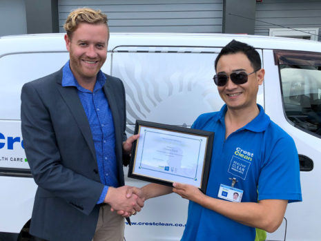 Daniel Park receives his long service award from Damon Johnson, CrestClean's Assistant Franchise Manager.