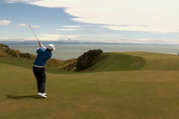 Golfer playing at Cape Kidnappers, Hawkes Bay