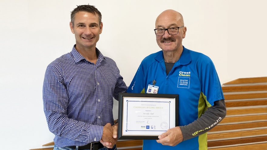 Cleaner receives long service award.
