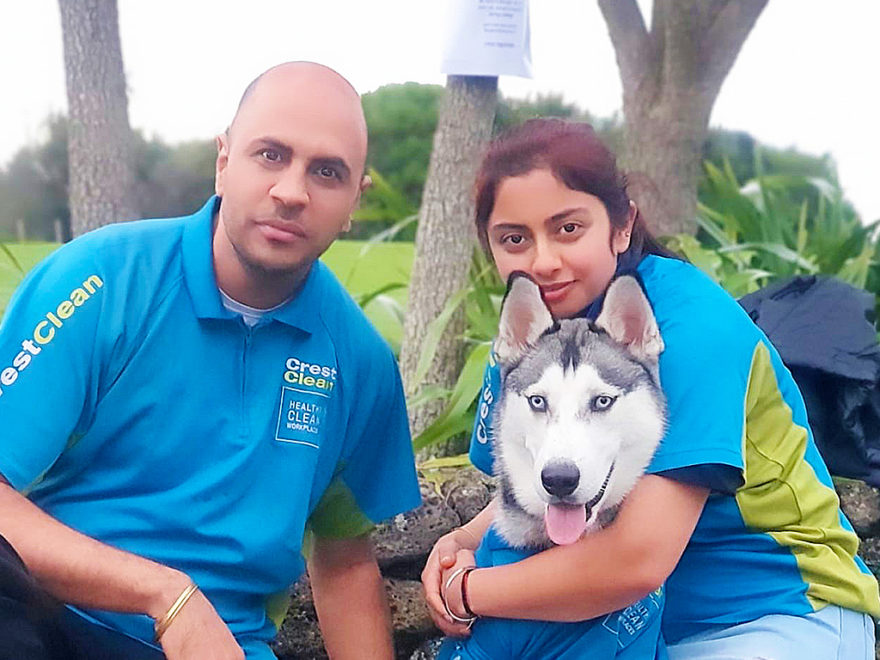 Cleaners with their dog.
