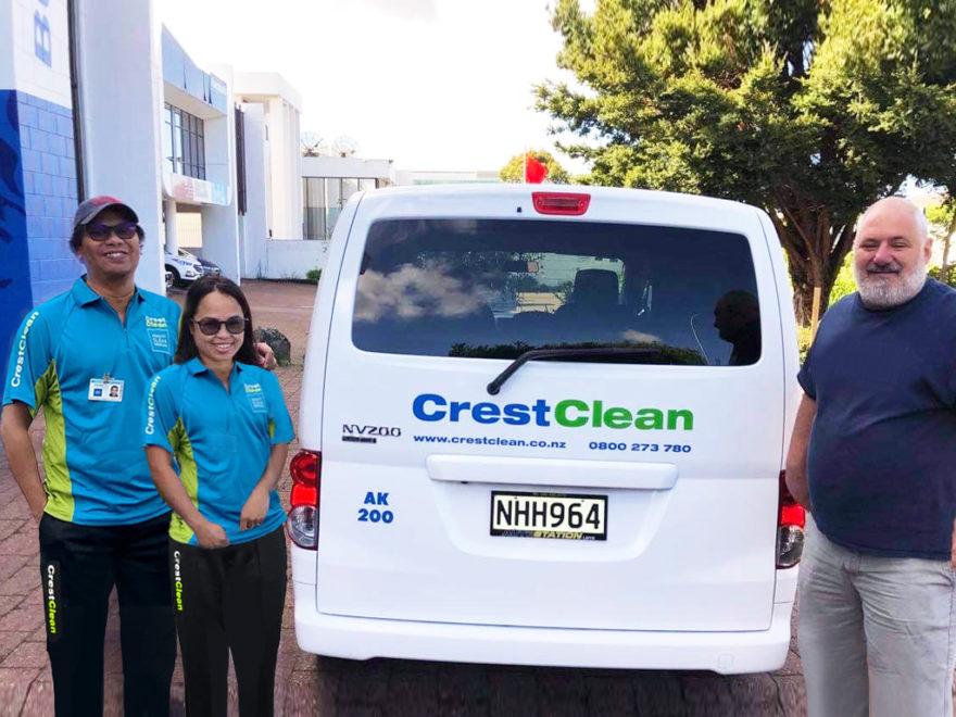 Cleaning team beside van.