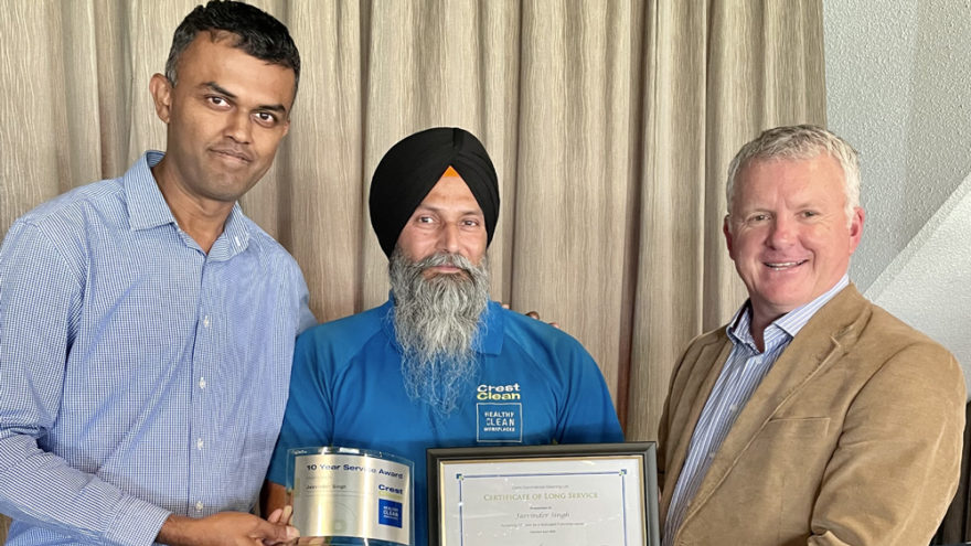 Cleaner presented with certificate.