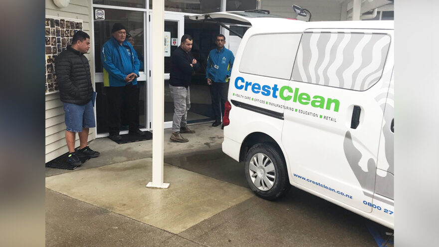 People looking at a cleaning van.