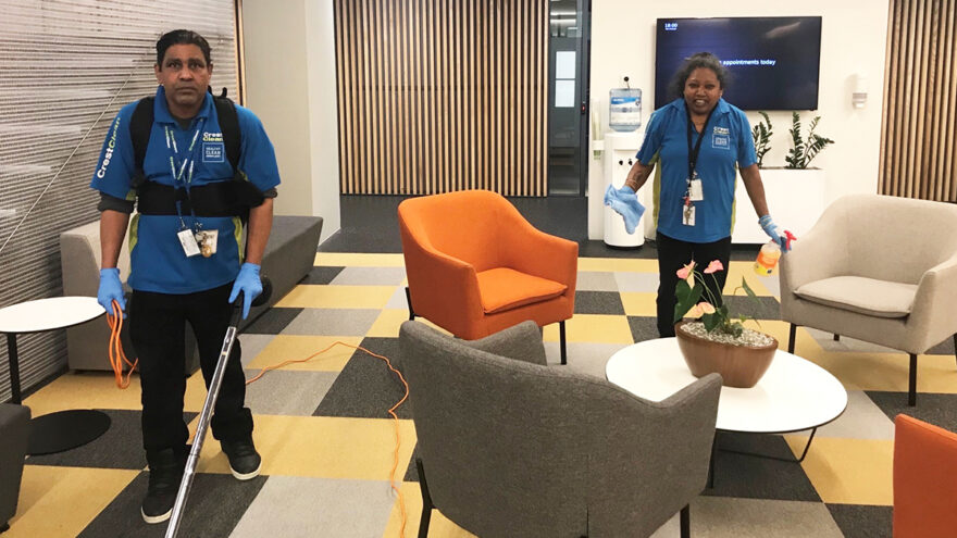 Cleaners cleaning an office space.
