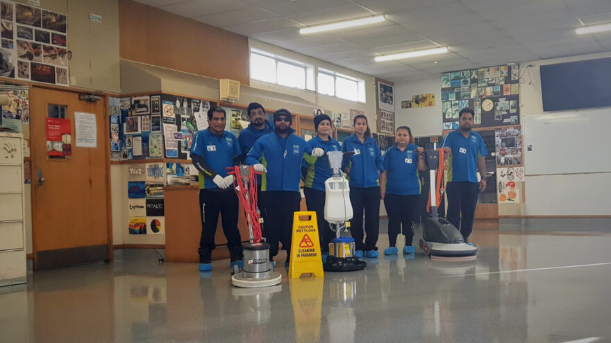 A line up of cleaners with floor cleaning machines.